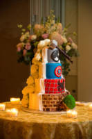 This cake by Jaques' Pastries was superheros on one side, and elegant on the other.