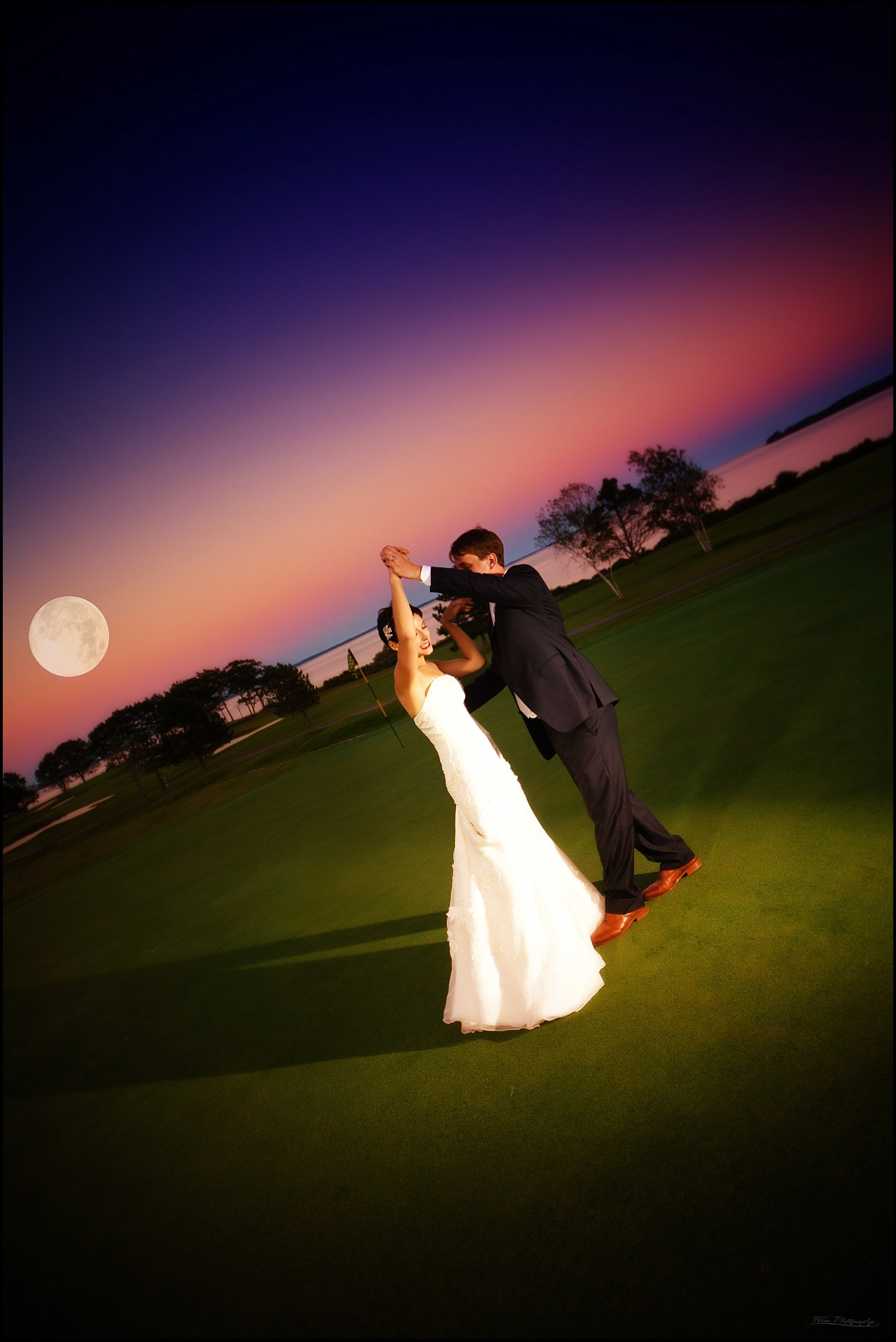 bridea and groom dancing on the golf course at twilight at samoset resort in rockport, me