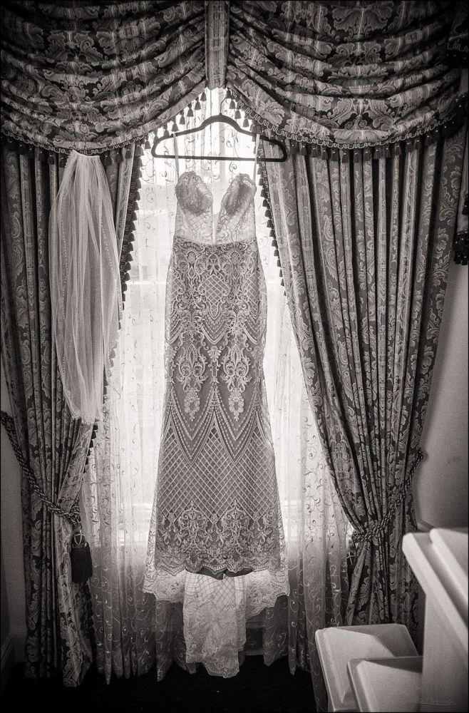 Wentworth by the Sea Wedding Pictures dress and veil hanging in window
