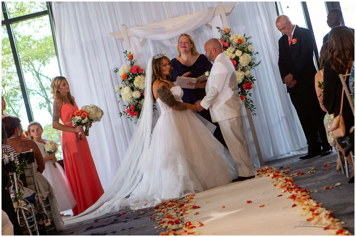 wedding couple exchanges vows at AC hotel's Envio event center