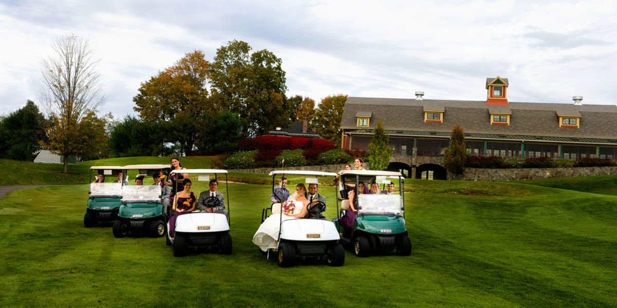 The wedding party in golf carts