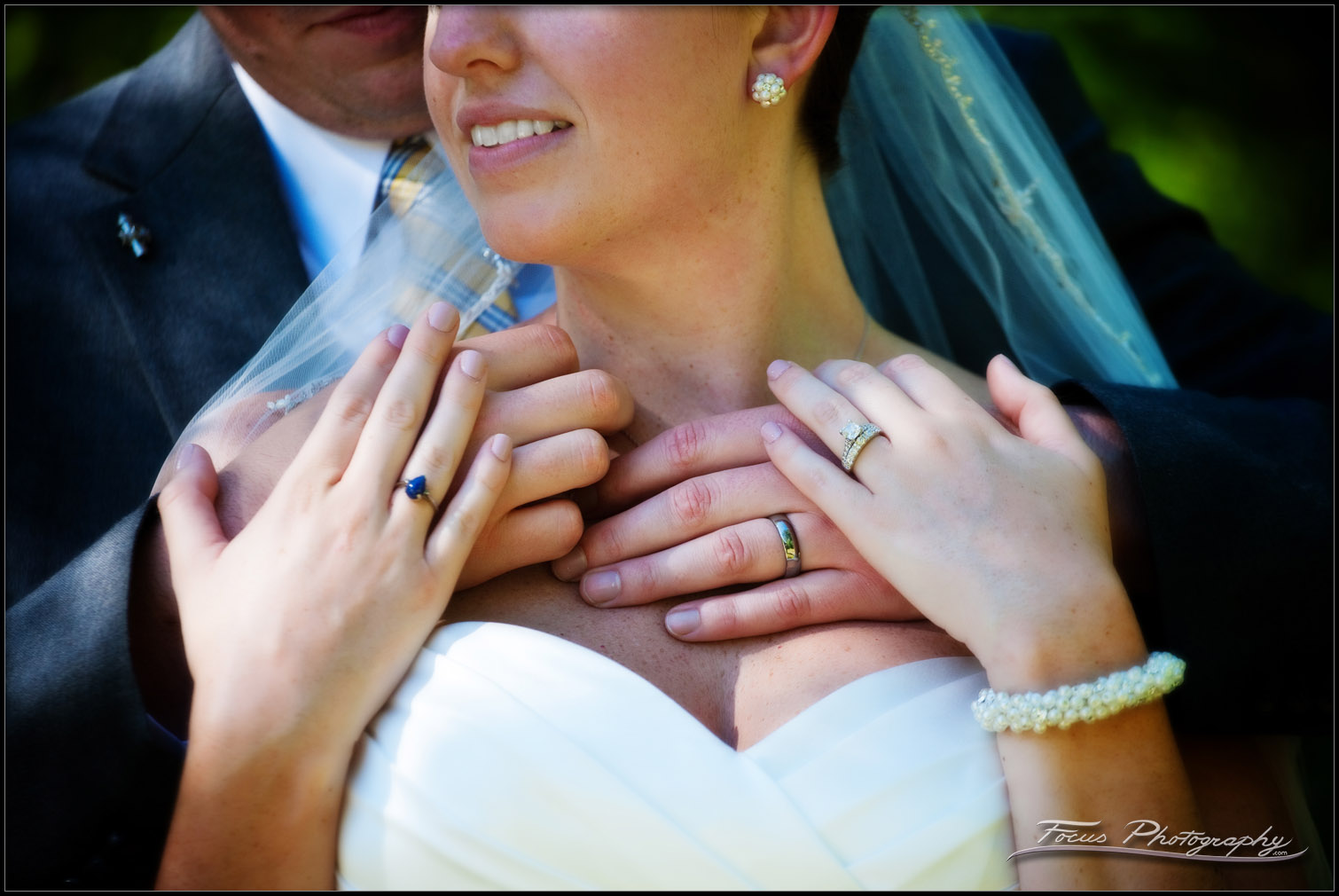 the wedding rings are well displayed on the bride