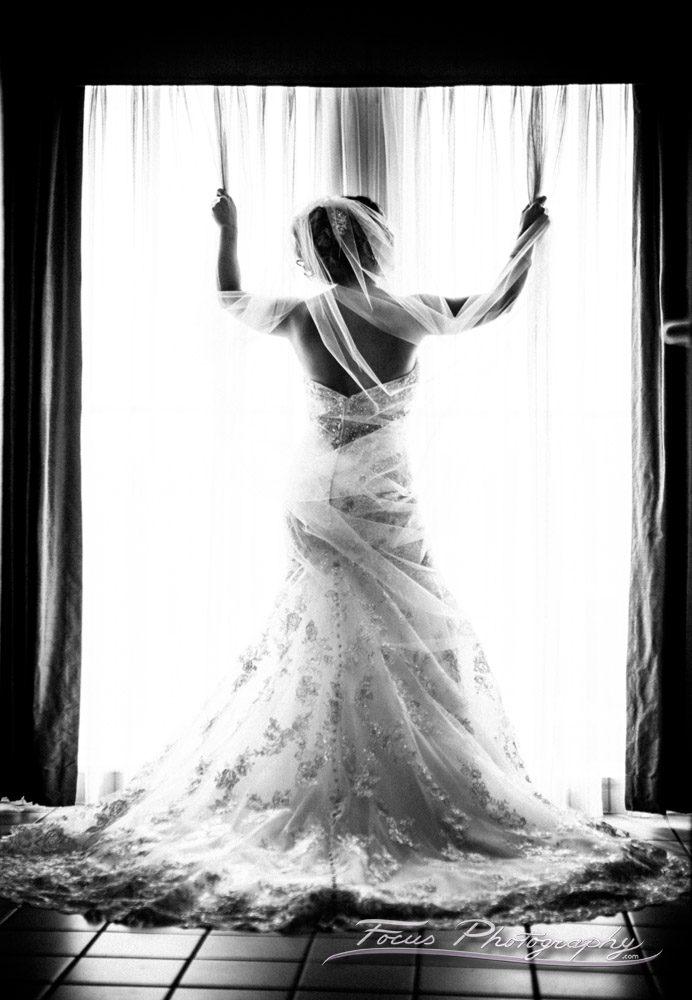bride in window Hilton Garden Inn, Auburn Wedding