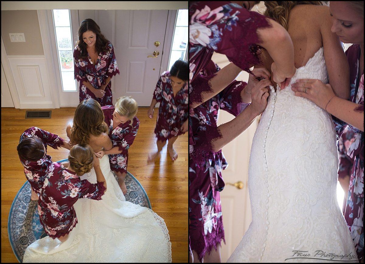 Bridesmaids helping the bride get dressed