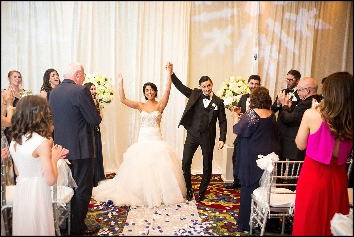 after ceremony couple looks triumphant
