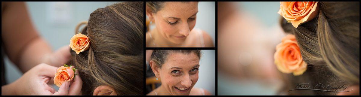 bride getting flowers in her hair