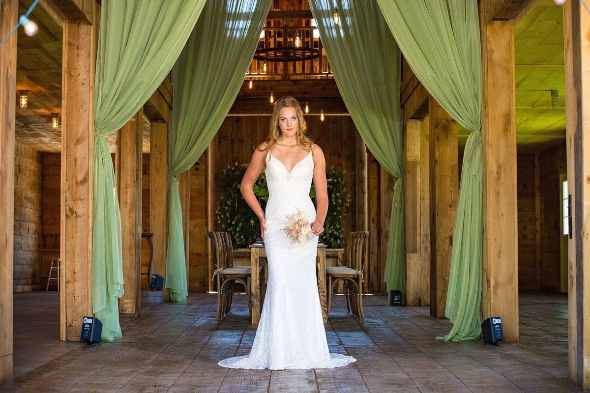 bride at river winds farm wedding in barn