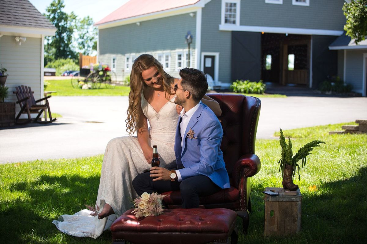 couple in front of barn