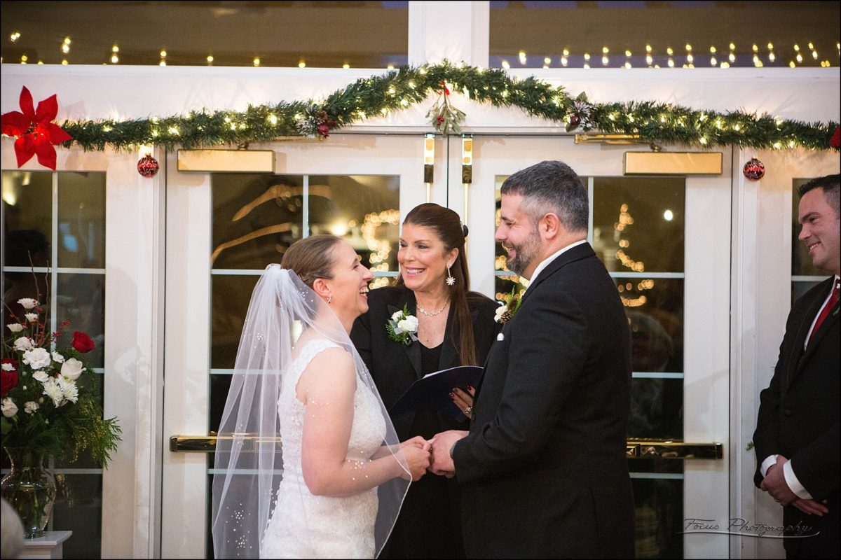 saying I do at  Village by the Sea wedding in Wells, Maine