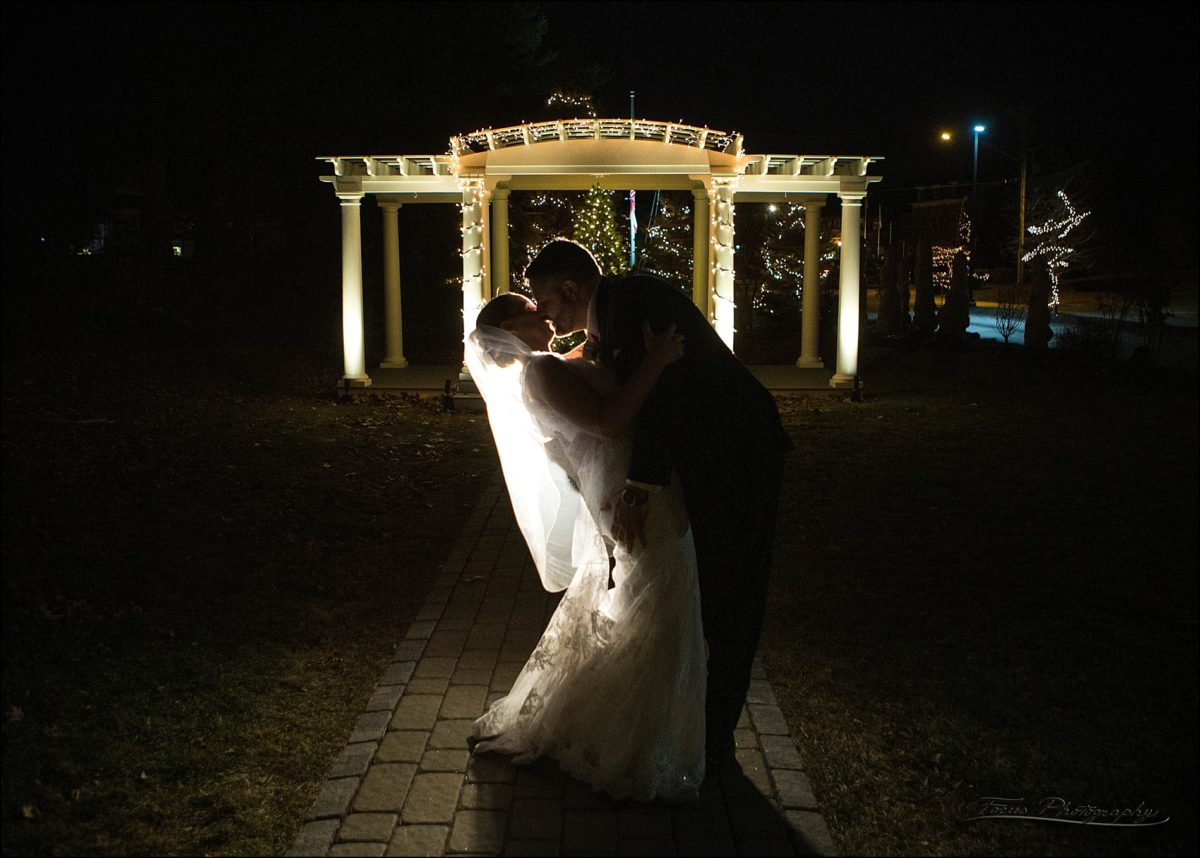 pergola and Christmas lights with couple in foreground