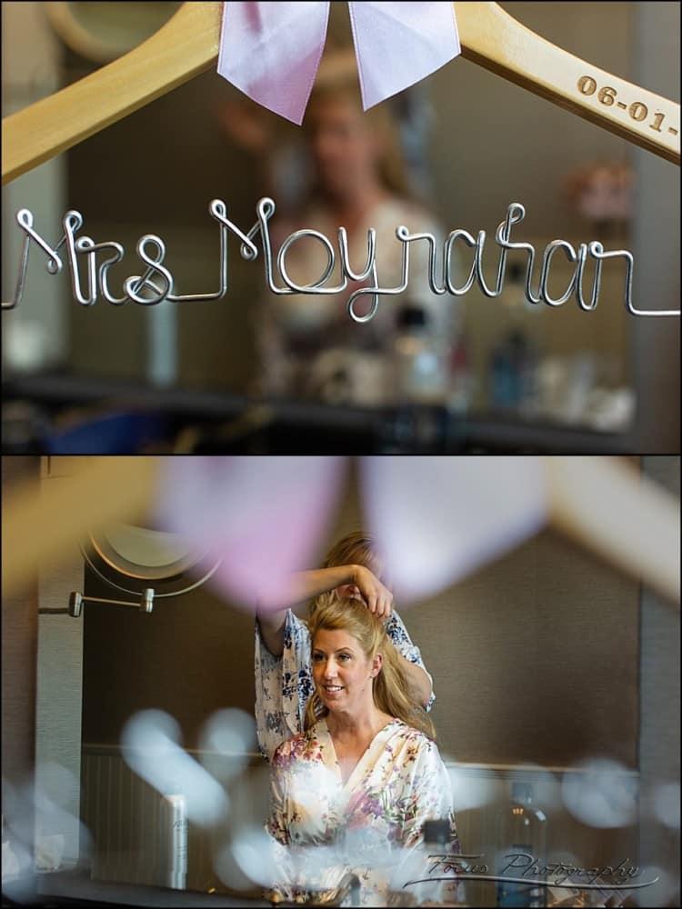bride photographed through wire art hanger.