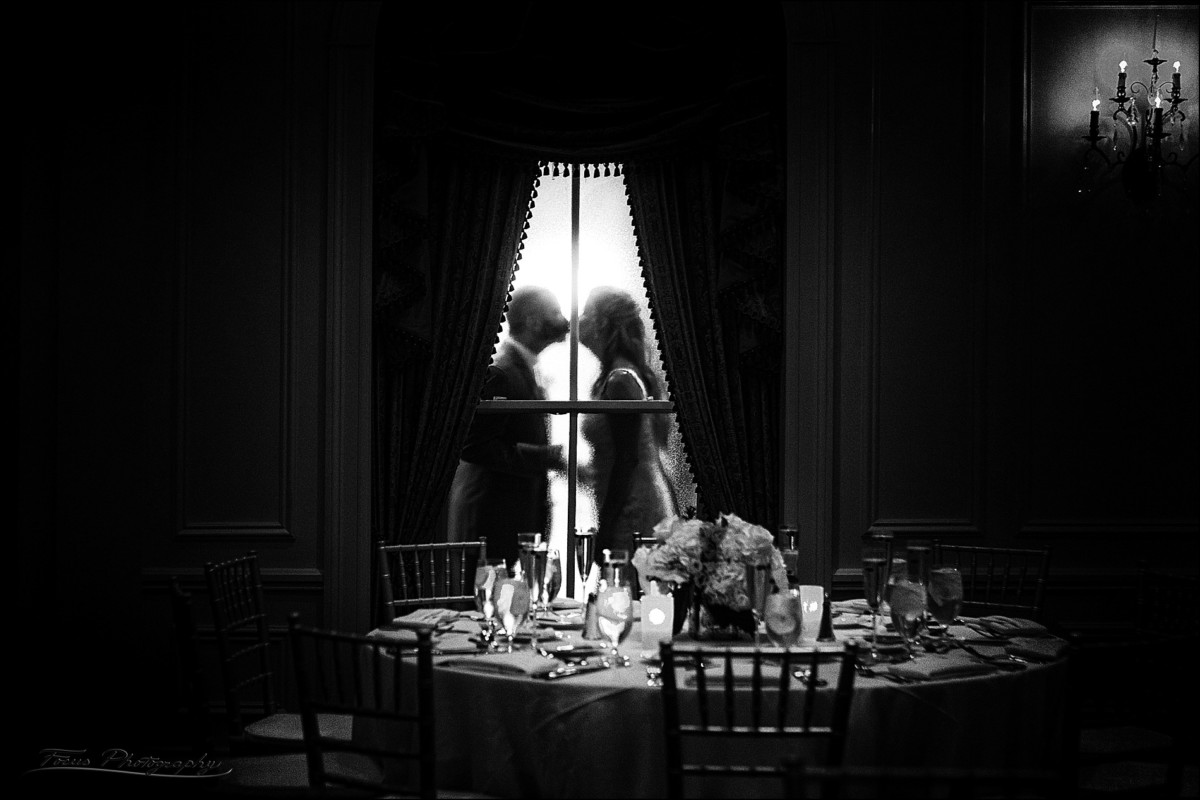 bride and groom photographed through a frosted window