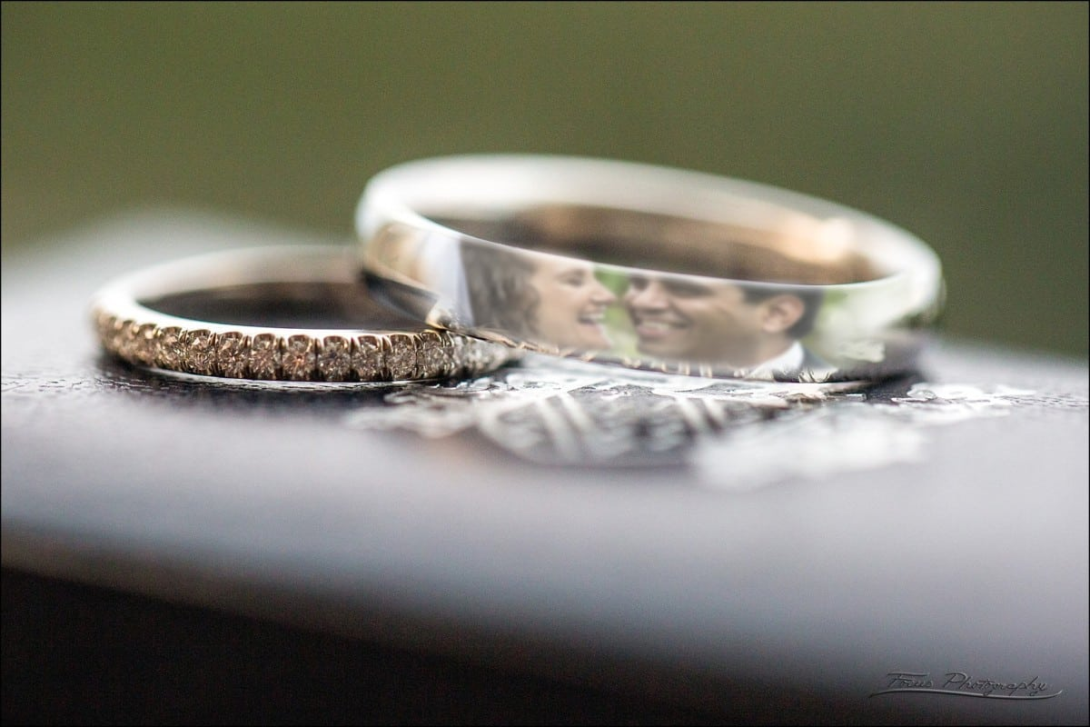wedding couple reflected in rings