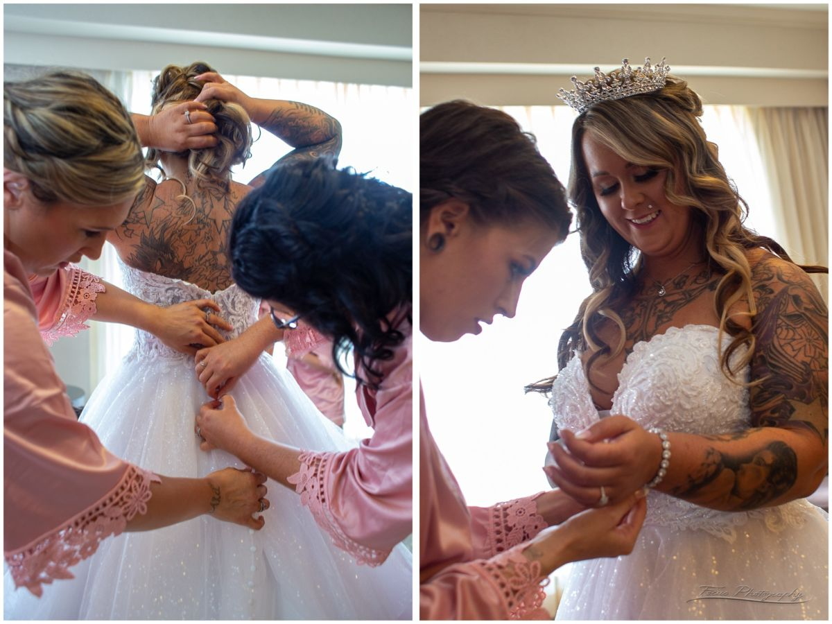 bridesmaids help with jewelry and getting dress butttoned