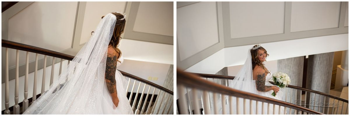 Bride descending the staircase at the Sheraton Hotel