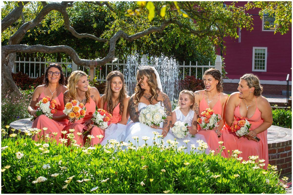 bride and bridsmaids laughing at Prescott Park
