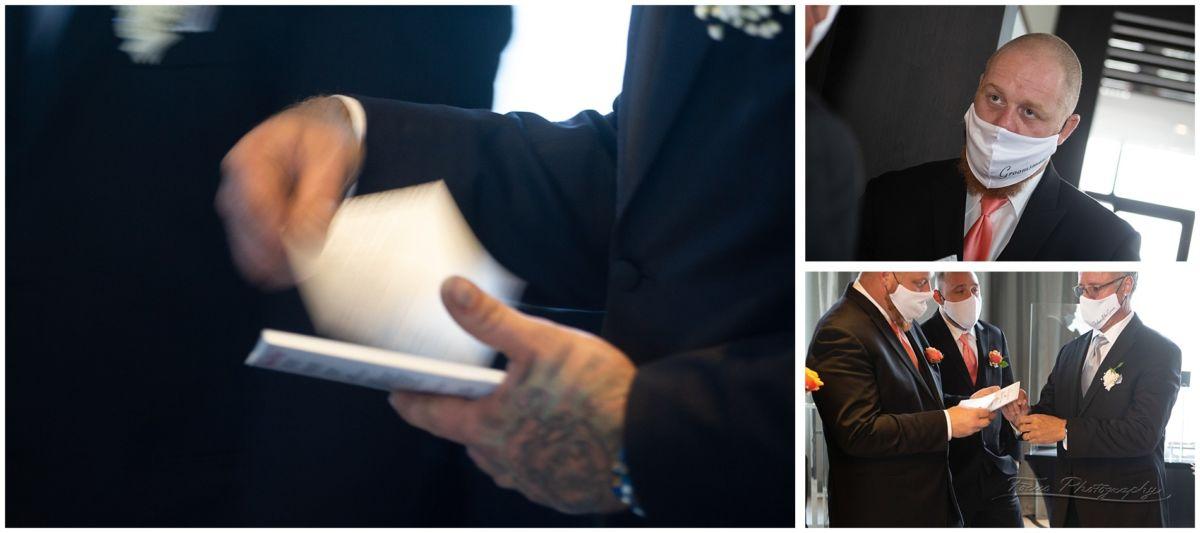 groomsmen handing out wedding programs