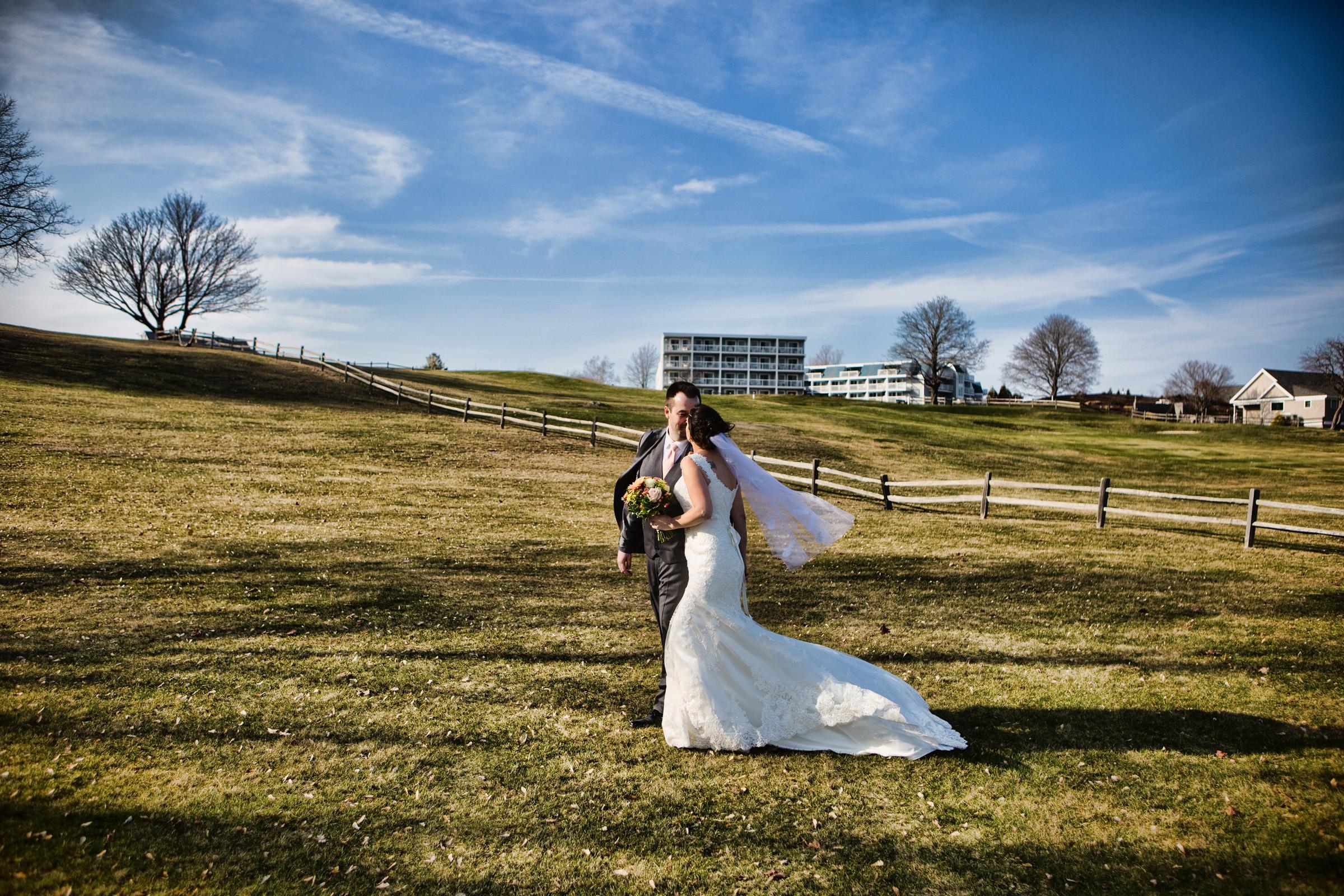 wedding couple walks uphill at samoset resort