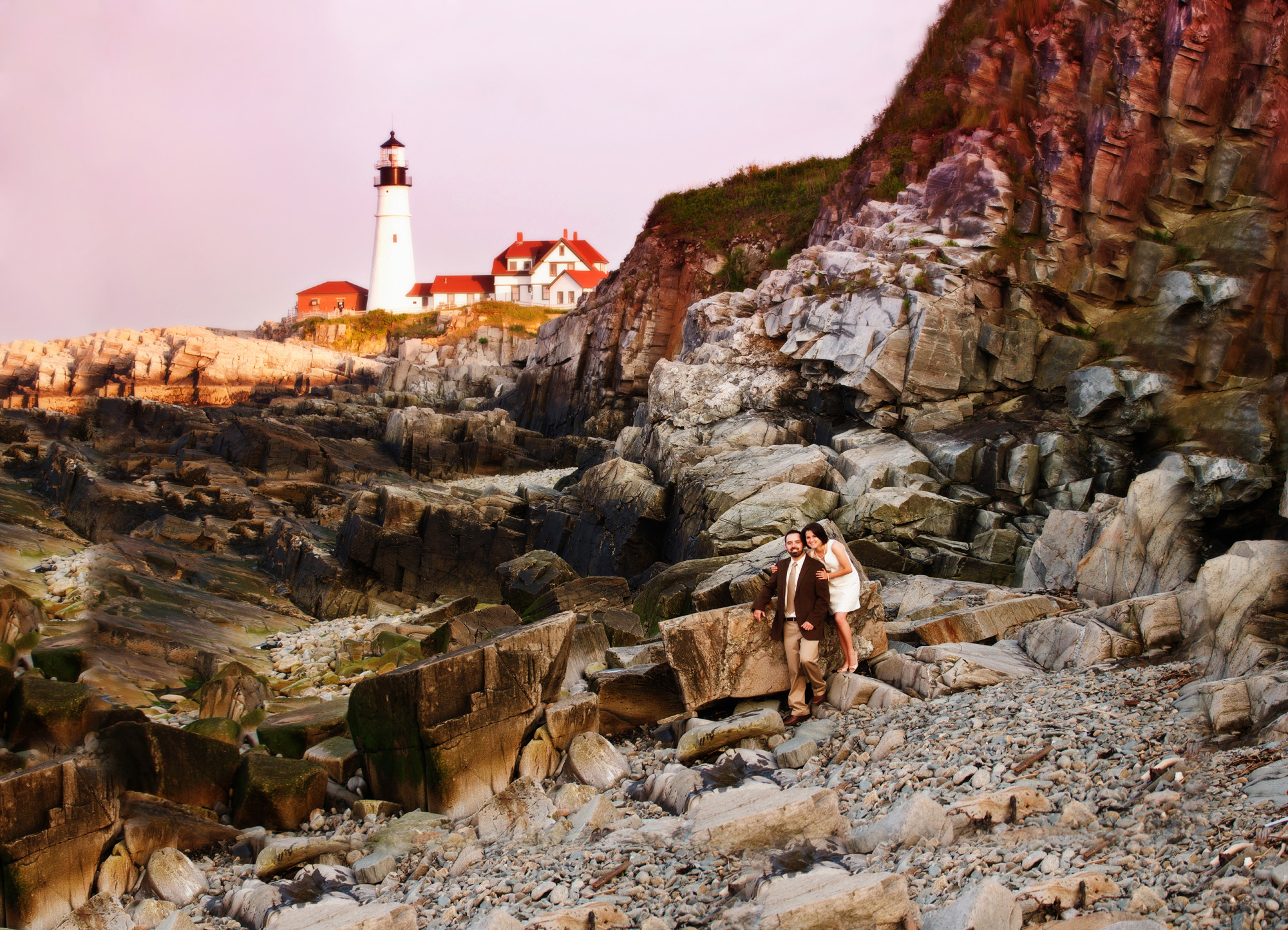 engagement picture with lighthouse in background in maine