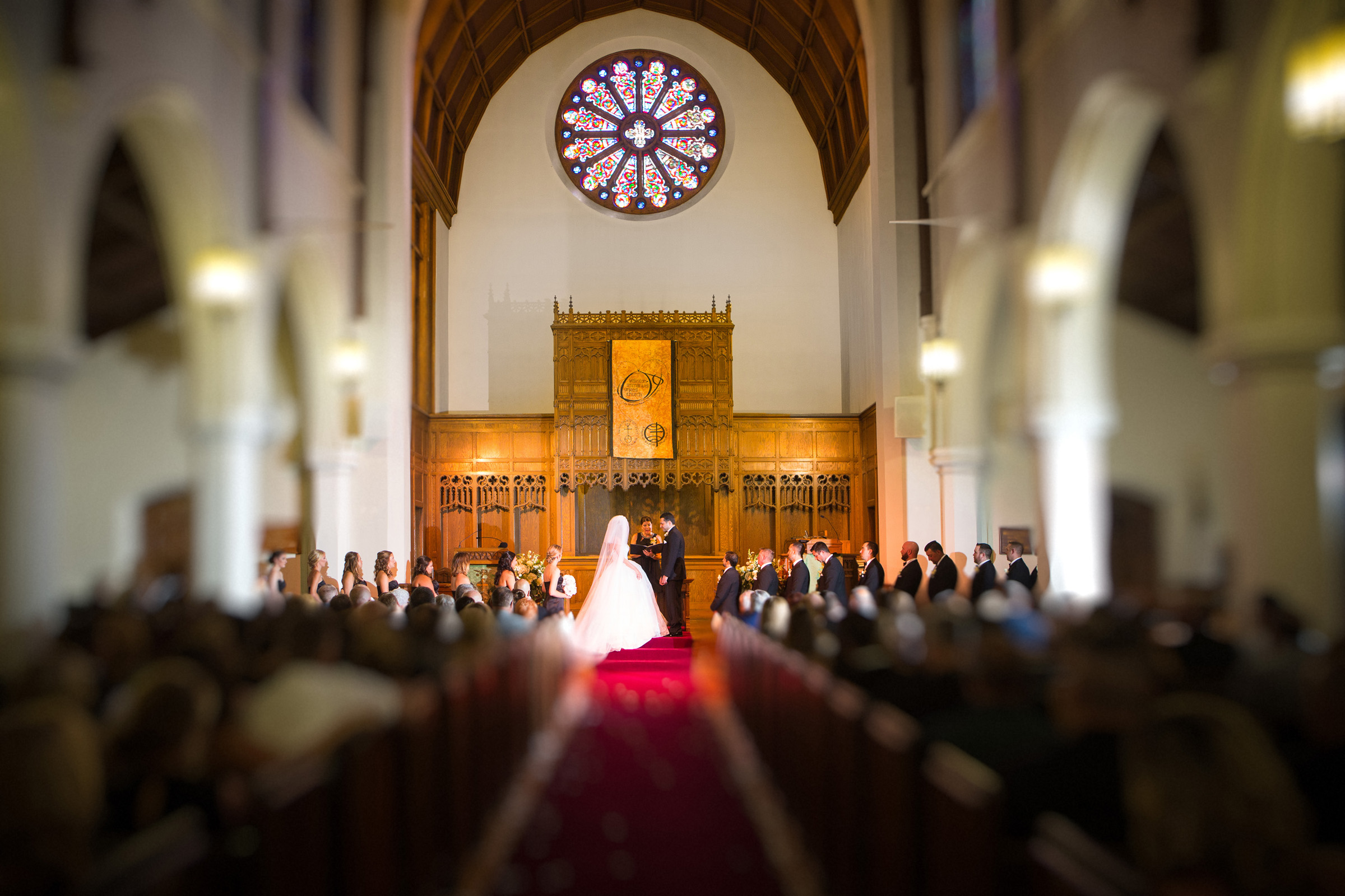 wedding in church with couple at altar