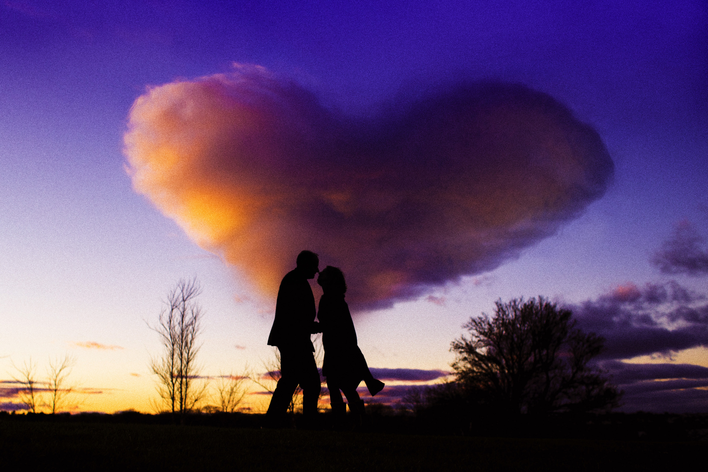 engagement picture with heart shaped cloud