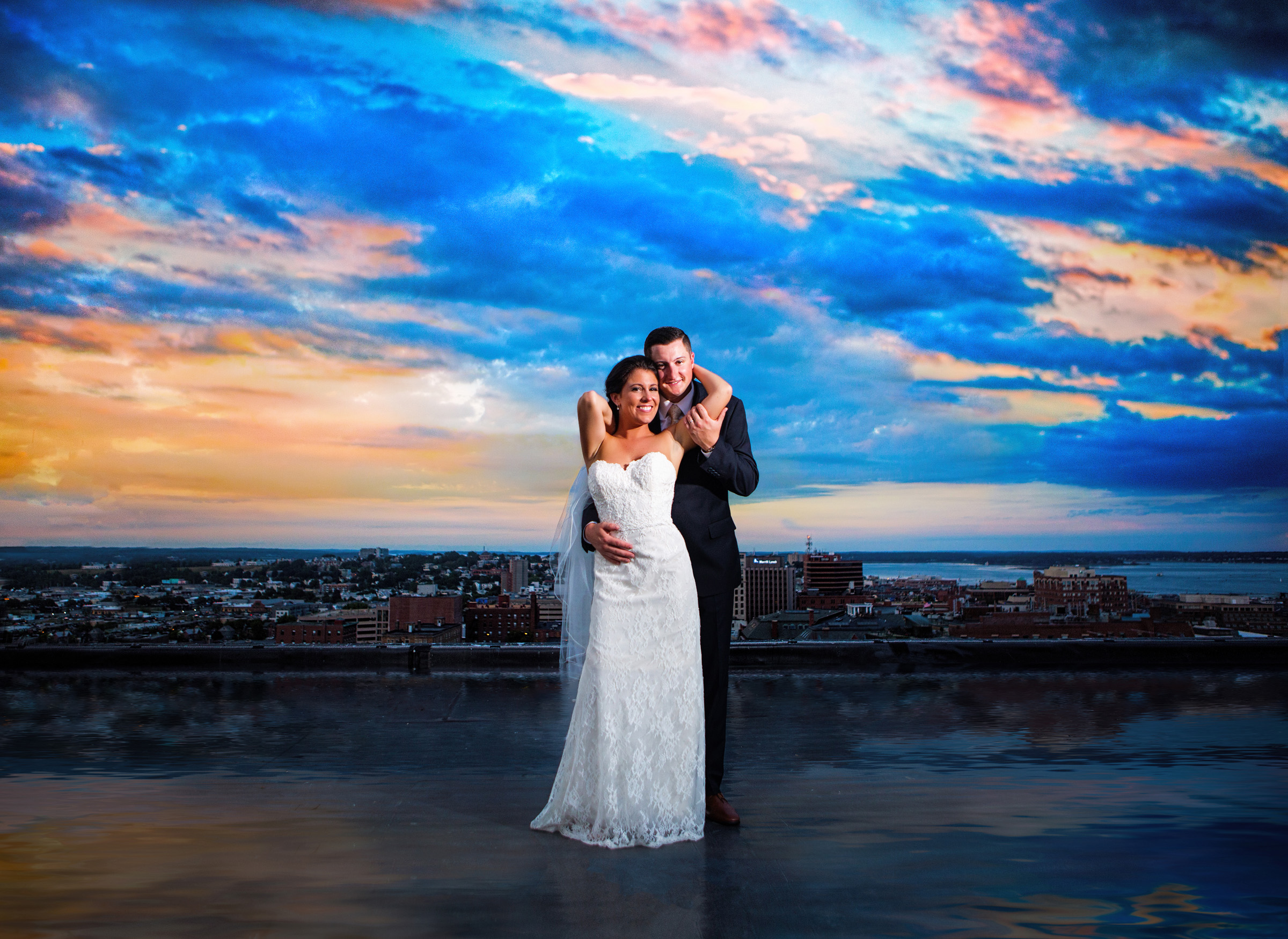 wedding couple on roof of portland, Maine's westin hotel