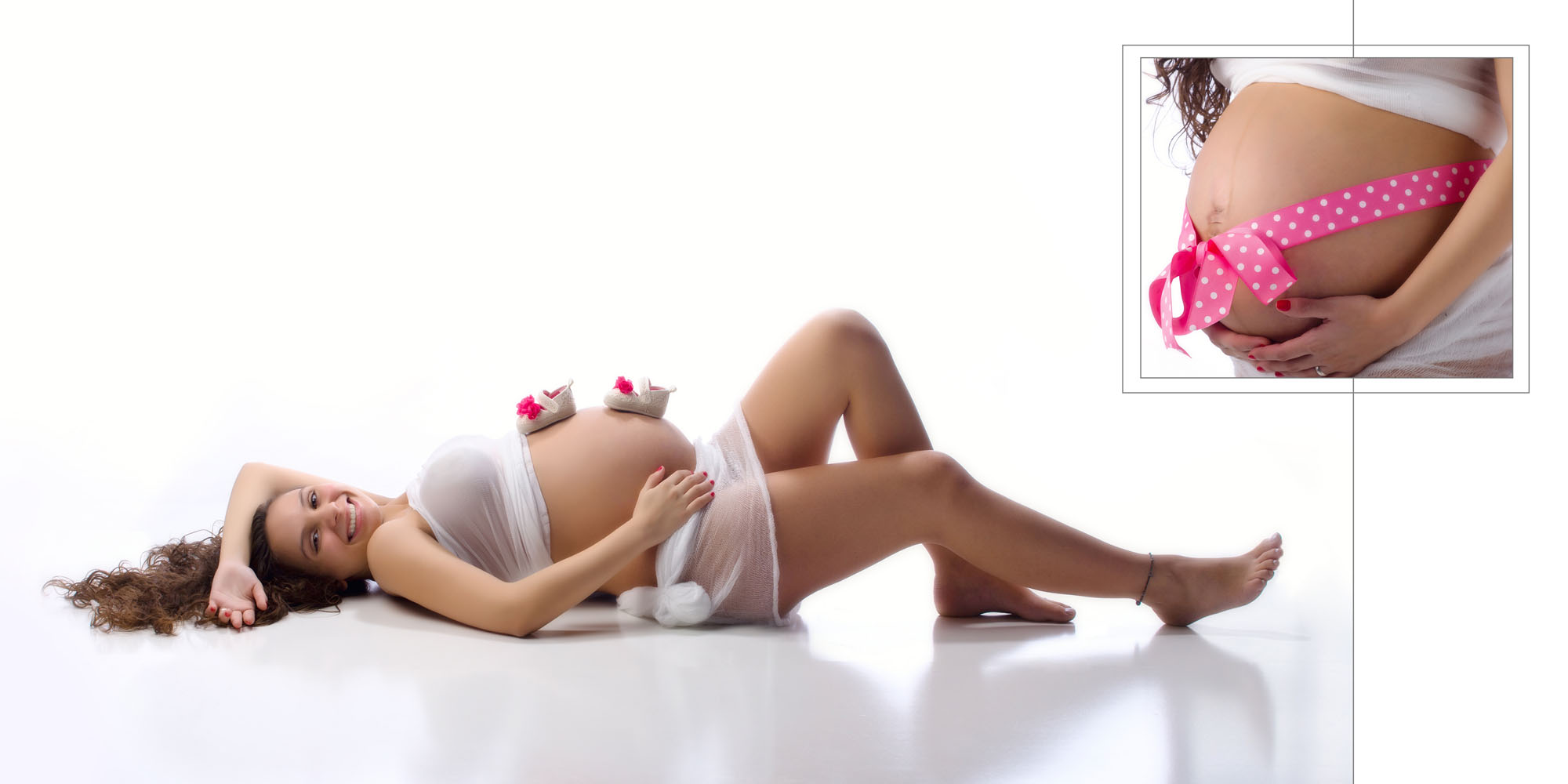 white fabric wraps a pregnant woman in maternity photo shoot