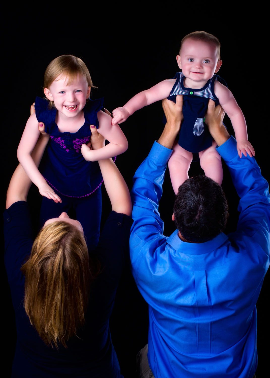 baby and child lifted over head for fun family pictures