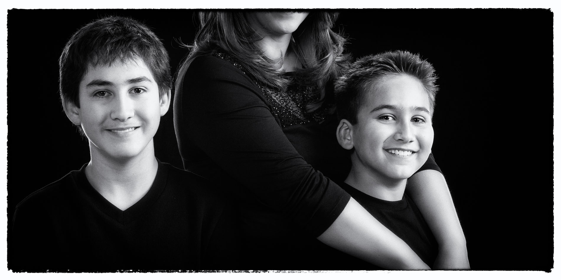 mom and her boys in black and white