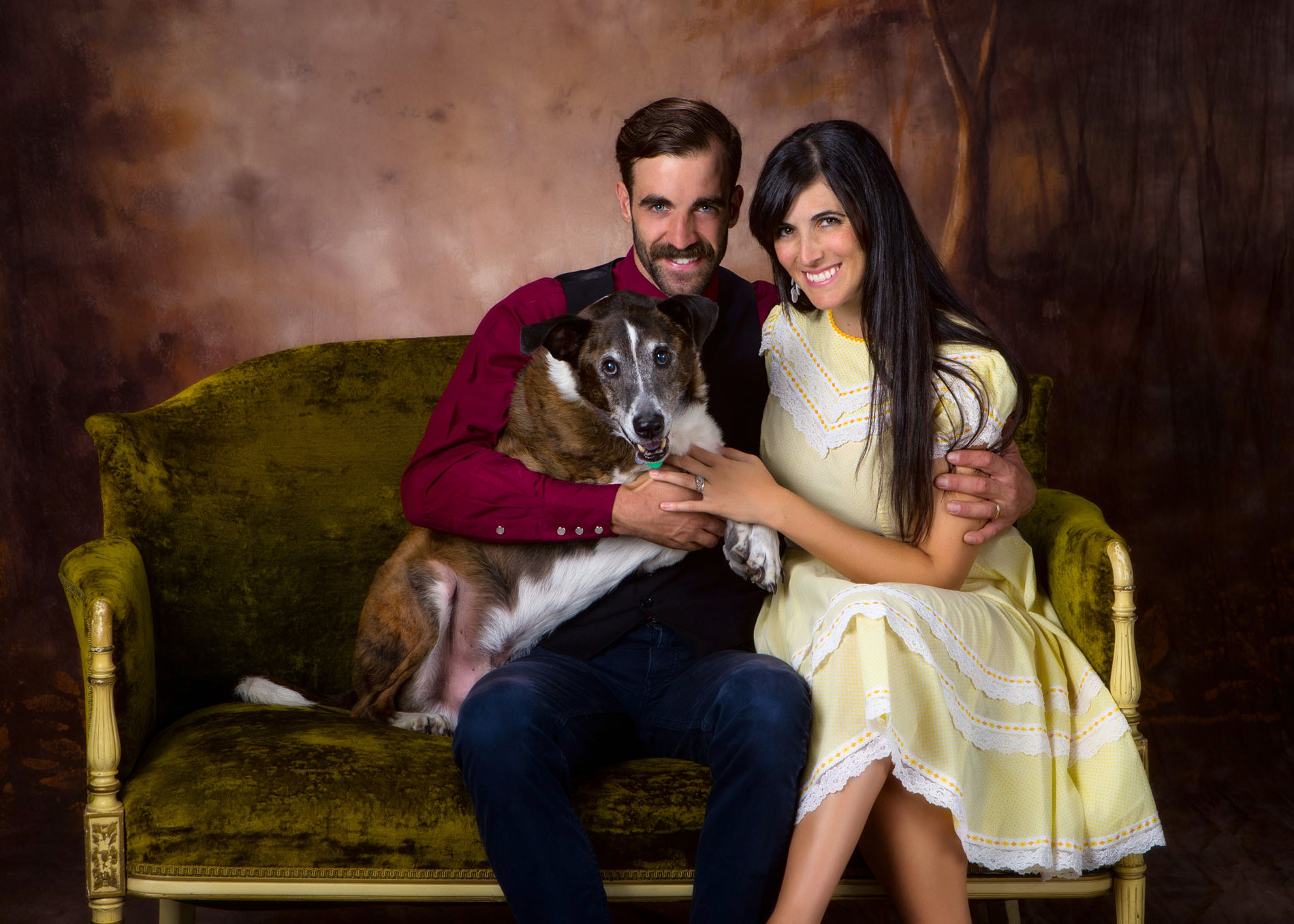 couple with their dog for family portrait