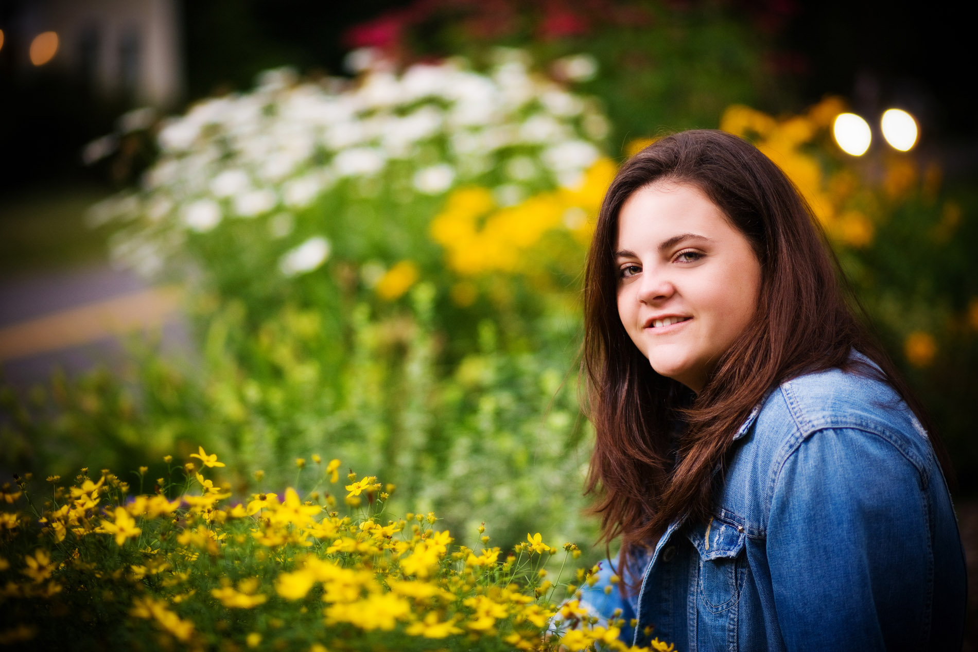 senior girl photographed among wildflowers in her back yard in maine