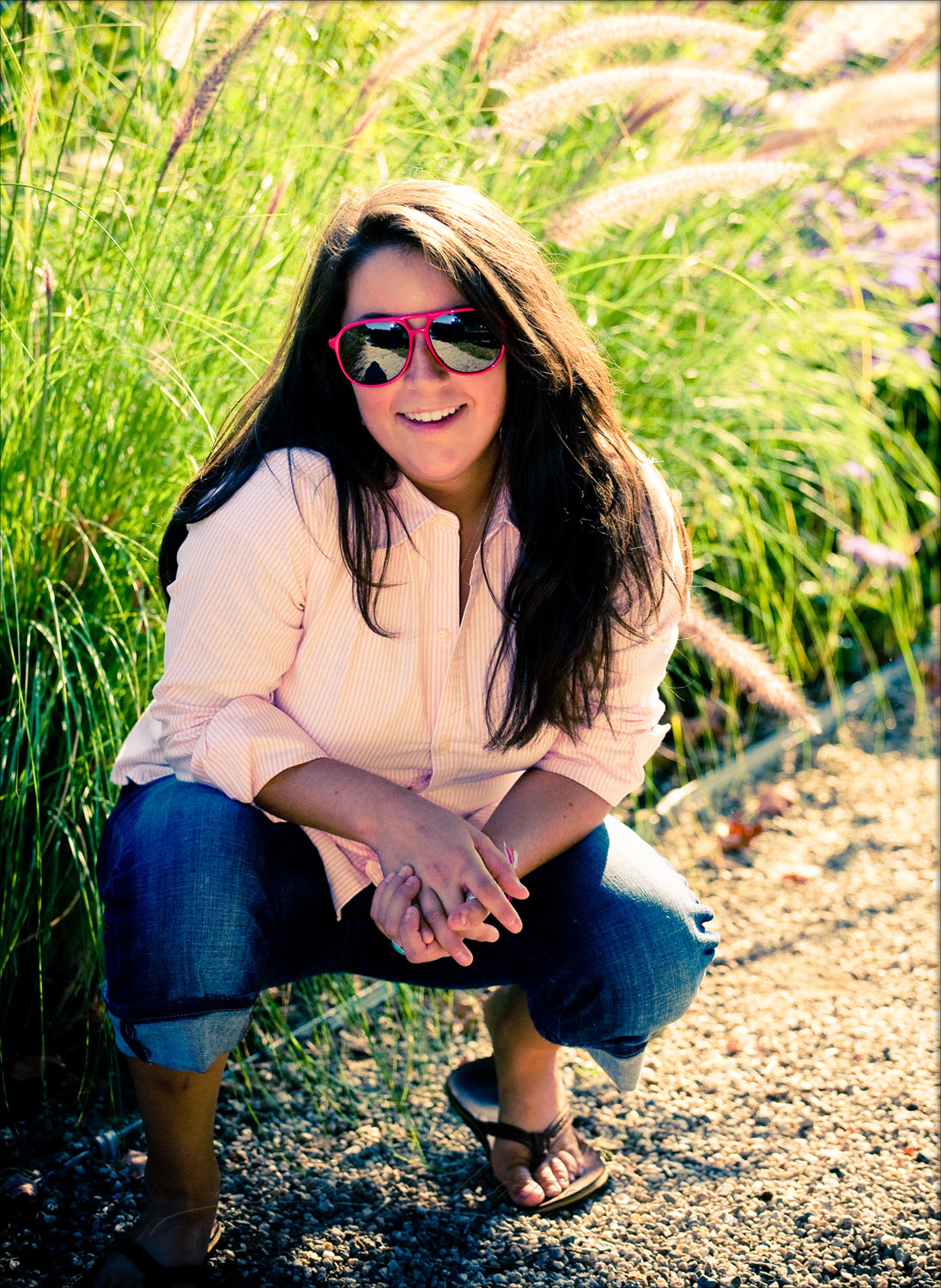 senior girl with red sunglasses in park in portland, maine for photo shoot