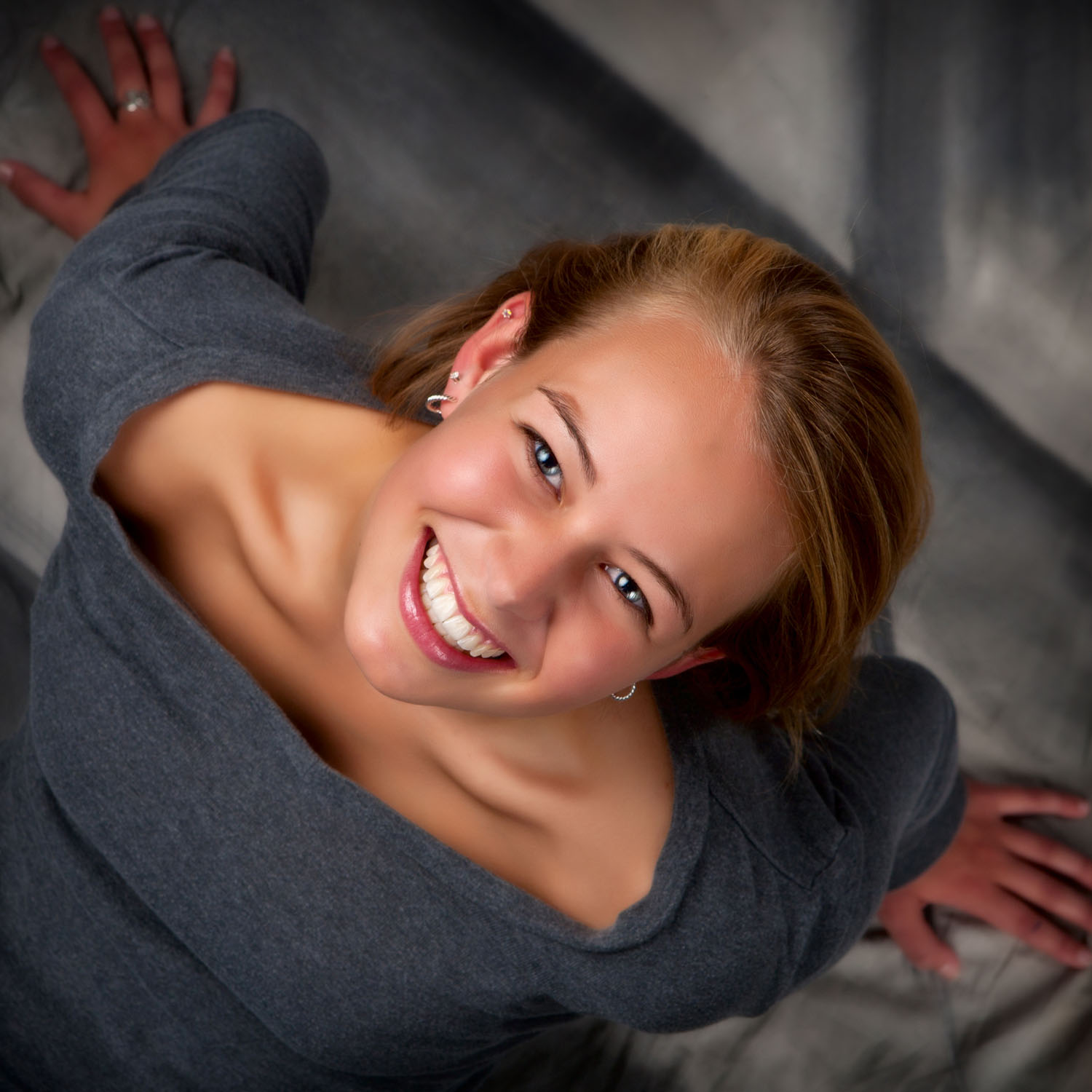 unique angle for senior picture taken straight down in photography studio