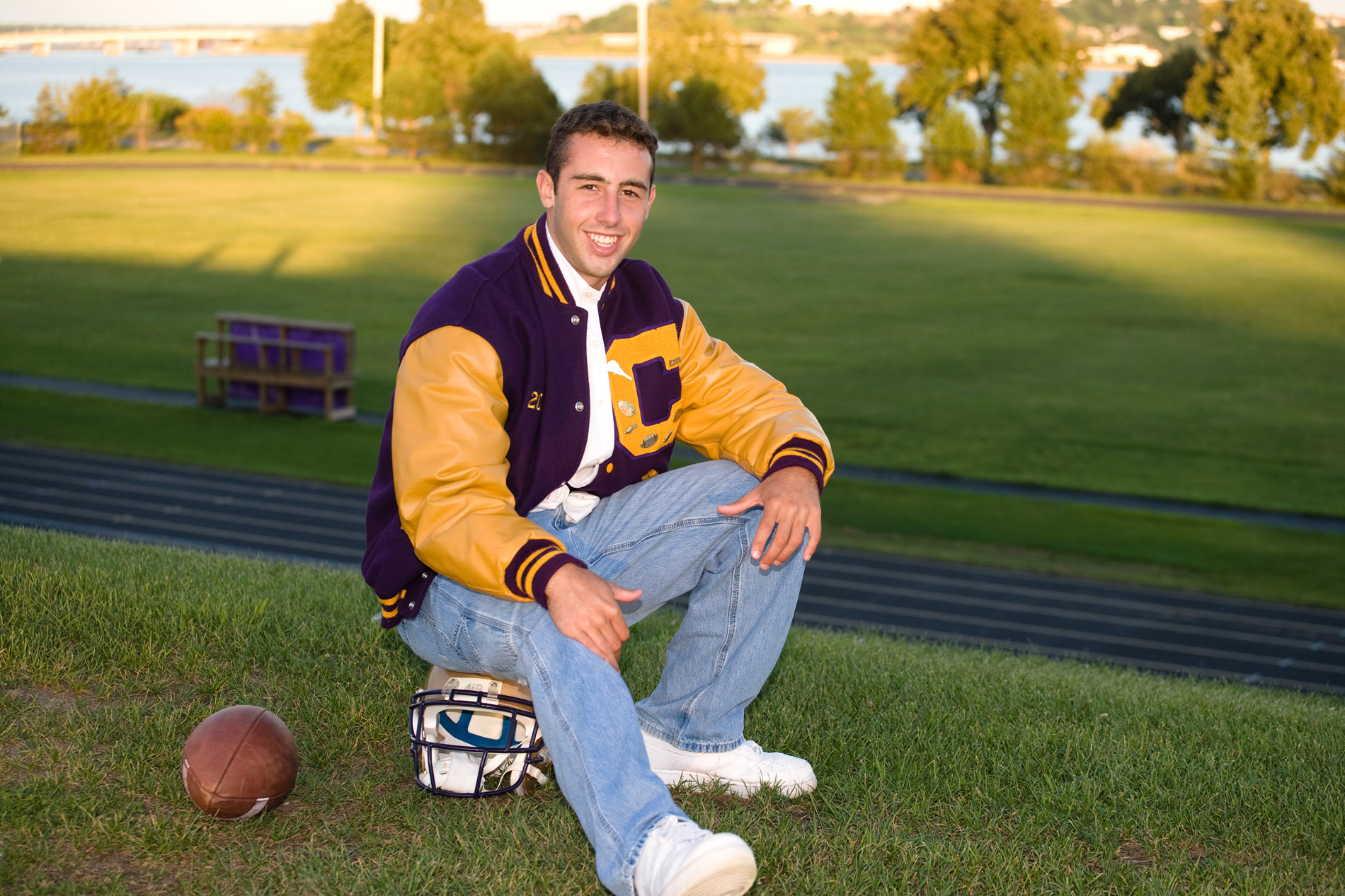 cheverus high school senior photographed at school football field in portland, maine