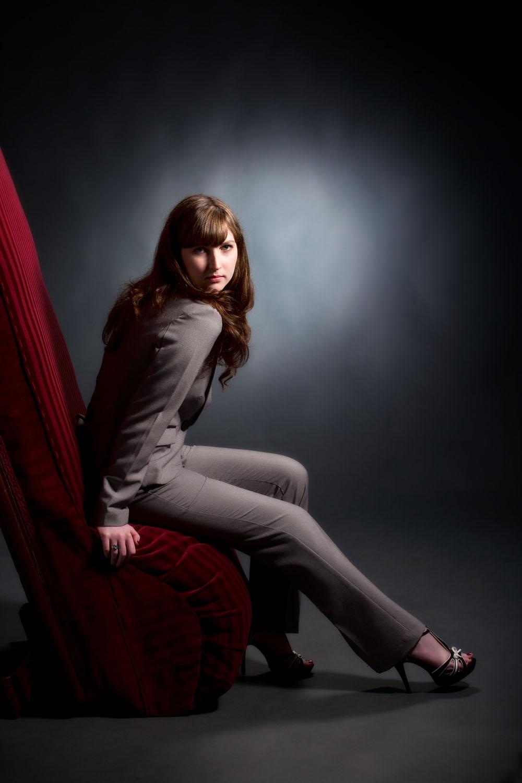 senior picture in studio of girl in grey suit