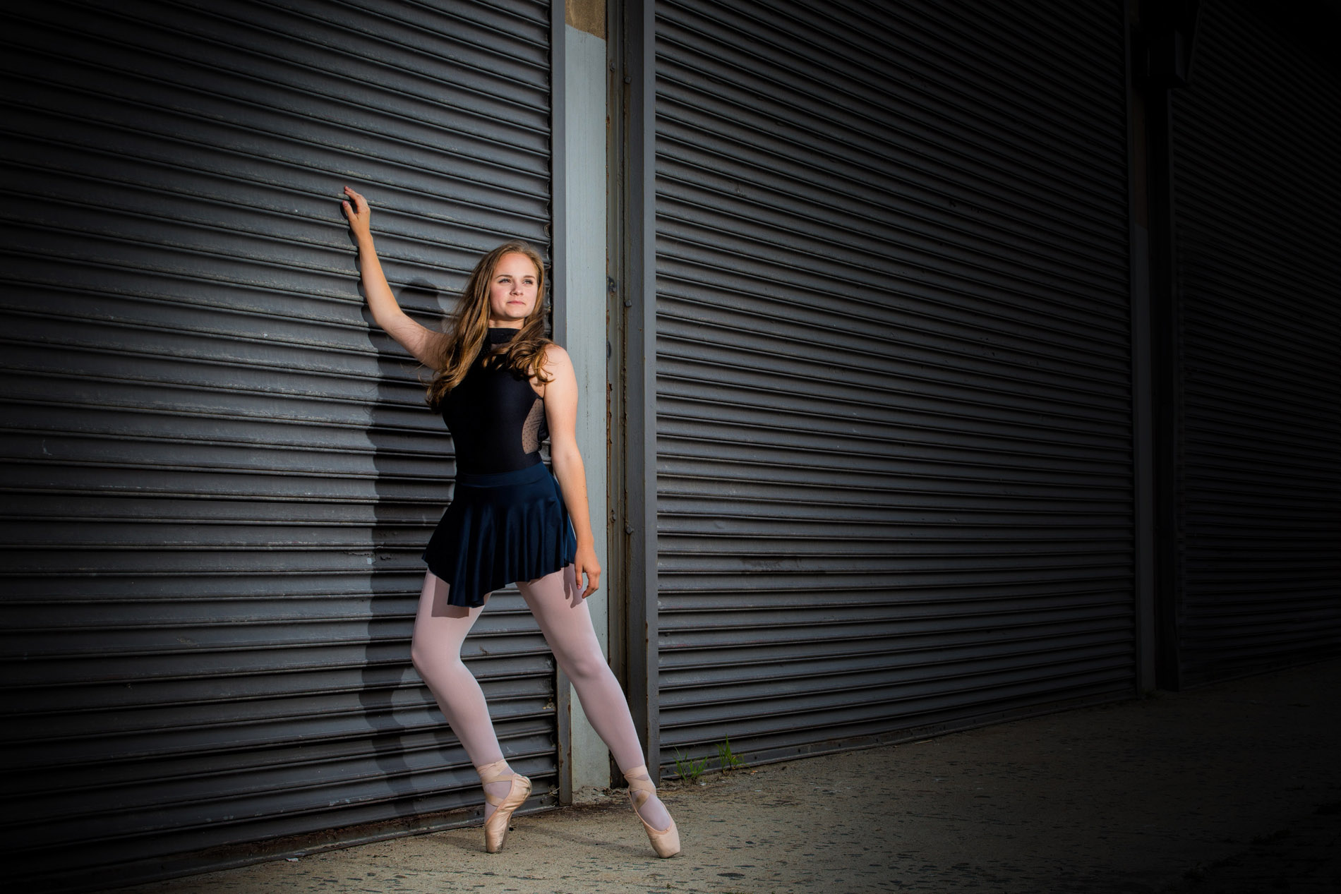 downtown portland's garage doors are backdrop for urban dance picture for high school senior